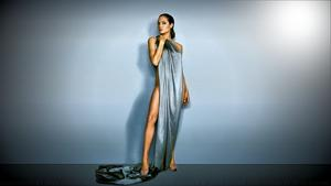 "Angelina Jolie  1 ""ALMOST"" Nude Wallpaper & one suggestive one."